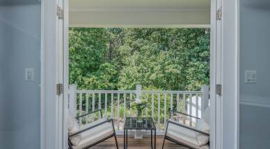 French doors from master suite lead to balcony deck