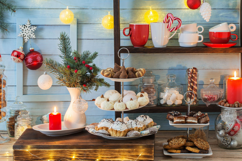 Christmas bar cacao decoration with cookies and sweets on blue wooden background