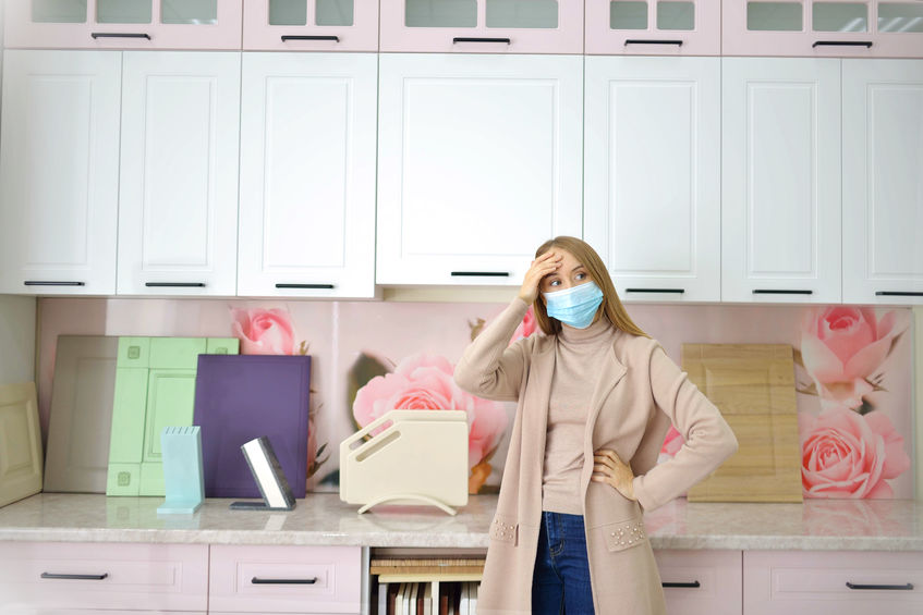 woman in kitchen during COVID pandemic