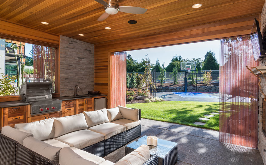beautiful covered outdoor kitchen patio with sitting area